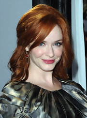At the world premiere of 'IRIS - A Journey Into the World of Cinema', Christina Hendricks wore a shiny, berry-colored lipgloss to complement her copper and green dress. To recreate her feminine look, we recommend a product like Korres Lip Butter Glaze in Raspberry.