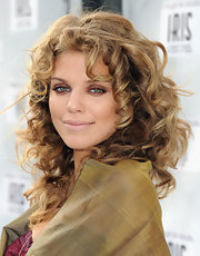 AnnaLynne McCord's hazel eyes were ultra vibrant at the world premiere of 'IRIS - A Journey Into the World of Cinema'. To try her look, heavily line only the inner rims of eyes with a kohl black eye pencil. Next, use a copper shade of eyeshadow over lids and along the lower lash line. Mascara is optional. To bring out blue eyes, try a gold shadow and for brown eyes, a silvery gray or deep blue shade would work well.