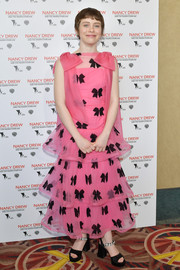Sophia Lillis styled her dress with a pair of bejeweled black platforms by Miu Miu.