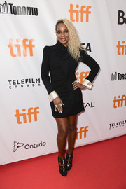 Mary J. Blige looked sharp in a strong-shouldered Gucci LBD with ruffle detailing and contrast cuffs at the TIFF premiere of 'Mudbound.'