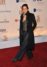 Walking the red carpet at the premiere of 'Not My Life', Tea Leoni worked a menswear-inspired ensemble completed by a heavy wool coat.