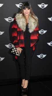 Zara Martin kept cozy with a red and black wool coat featuring a fur collar during the new Mini world premiere.