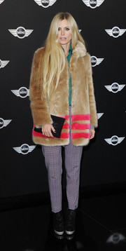 Laura Bailey glammed it up in a tan fur coat with pink stripes during the new Mini world premiere.