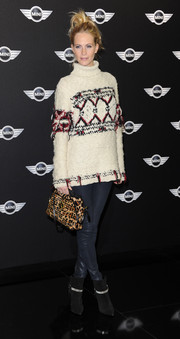 Poppy Delevingne looked all set for winter in a cozy white turtleneck during the new Mini world premiere.