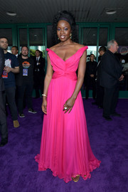 Danai Gurira glammed up in a Barbie-pink off-the-shoulder gown by Oscar de la Renta for the world premiere of 'Avengers: Endgame.'