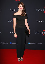 Emma Birdsall went for simple elegance with a black off-the-shoulder top and slacks at the 'World War Z' Australian premiere.