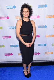 Ilana Glazer wore a black halter crop-top that showed a little bid of midriff for her chic ensemble