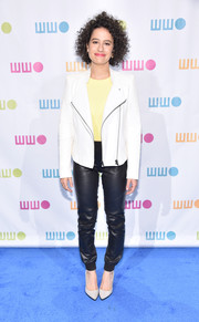 Ilana Glazer nailed the leather-on-leather look with this black pants and white jacket combo.