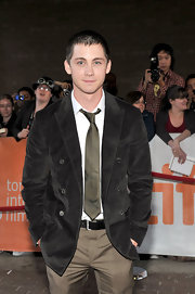 Logan Lerman paired a black pea coat with khakis for a smart finish during the premiere of 'Writers.'