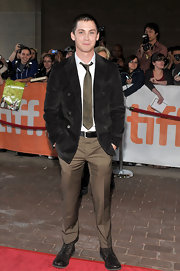 Logan Lerman's black combat boots were a grungy complement to his smart outfit at the 'Writers' premiere.