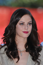 Kaya Scodelario wore her hair in bouncy curls at the premiere of 'Wuthering Heights.'