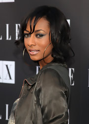 Singer Keri Hilson paired her romper with a casually cool wavy shoulder length haircut.
