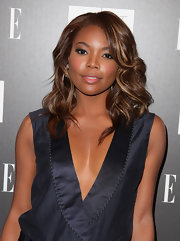 Gabrielle Union showed off her shoulder length curls while hitting the Armani Exchange party.