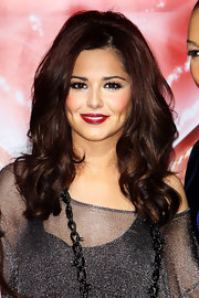 Singer Cheryl Cole attended the 'X Factor' press conference showing off glossy berry lipstick.