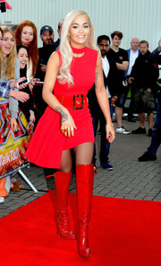 Rita Ora sealed off her head-turning retro look with a pair of red patent over-the-knee boots by Giuseppe Zanotti.