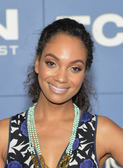 Lyndie Greenwood opted for a simple curly ponytail when she attended the 'X-Men' world premiere.