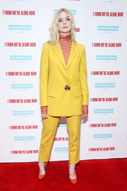 Elle Fanning looked vibrant in a yellow Oscar de la Renta pantsuit teamed with a red striped turtleneck at the special screening of 'I Think We're Alone Now.'