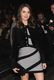 Alison Brie finished off her modern look with a black chainmail clutch when she attended the Y-3 fashion show.