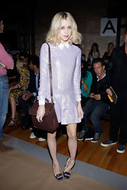 Peaches shined at Fashion Week in a lilac lurex dress with a white collar. She finished off the look with a brown satchel.