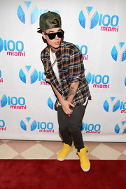 Justin Bieber attended the 2012 Jingle Ball in yellow high tops.