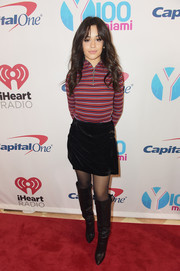 For her footwear, Camila Cabello went edgy with a pair of black knee-high boots.