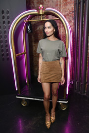 Zoe Kravitz teamed her shirt with a tan suede mini skirt.