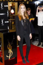 Cara Delevingne looked sharp in a black leather-lapel blazer during the YSL Loves Your Lips party.
