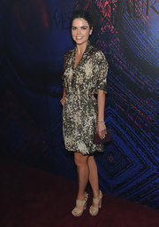 Katie looked chic in a printed olive dress with neutral platform sandals.