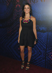 Shoshanna looked adorable in a tiered black dress with colorful details and a mesh pair of platform sandals.
