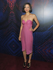 Maggie looked sweet in a pink chiffon strapless dress with a short bob and strappy sandals.