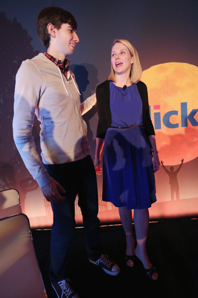 Marissa Mayer paired a simple blue dress with a black cardigan for a Yahoo news conference.