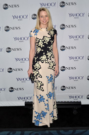 Marissa Meyer went for some springtime charm in a flowing floral gown during the Yahoo News pre-White House Correspondents' Dinner party.