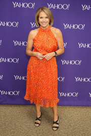Katie Couric chose a pair of black strappy sandals to team with her vibrant dress.