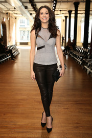Emmy Rossum was rocker-chic at the Yigal Azrouel fashion show in a multi-textured fitted blouse and leather skinnies.