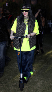 Billie Eilish layered a brown vest over a neon-yellow tee for Coachella 2019.