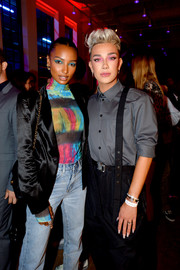 Jasmine Tookes teamed a black satin blazer with a multicolored turtleneck and faded jeans for the YouTube.com/Fashion launch.