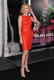 Charlize Theron wore a bright orange leather dress to the premiere of 'Young Adult.'