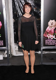 Diablo Cody wore a black mesh dress to show off her tattoos at the 'Young Adult' premiere.