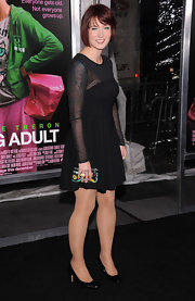 Diablo COdy was fun and flirty in a festive LBD at the 'Young Adult' premiere. She opted for black patent leather pumps to finish off the look.