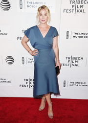 Christina Applegate paired her dress with simple yet elegant nude patent sandals.