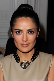 Salma Hayek was the epitome of chic at the Yves Saint Laurent show in Paris. To get her retro liner look, start by sweeping black liquid liner across the upper and lower lids, as close to the lash lines as possible and from the very inner corners to slightly past the outer corners. To finish the look add a few coats of a volumizing mascara.