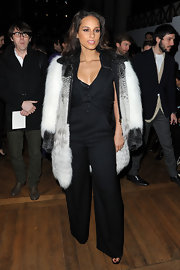 Alicia Keys added wow to her black jumpsuit with a white fur coat.