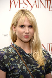 Lucy Punch was casually coiffed with barely-there waves and wispy bangs at the 'Yves Saint Laurent' premiere.