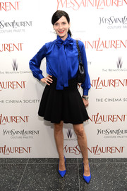 Michele Hicks kept it conservative and classic in a long-sleeve cobalt tie-neck blouse during the premiere of 'Yves Saint Laurent.'