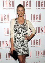 Yvonne went the safe route with a black patent clutch while attending Tabu Ultra Lounge. Her leopard print dress was a bit loud, so a simple clutch probably was the best choice.