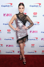 Hailee Steinfeld made a flashy choice with this asymmetrical sequin and lace number by Rasario for Z100's Jingle Ball 2016.