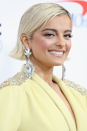 Bebe Rexha styled her hair into a slick straight cut with flipped ends for Z100's Jingle Ball 2018.