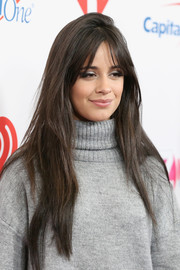 Camila Cabello wore her hair in a long straight style with parted bangs during Z100's Jingle Ball 2019.