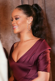 Rihanna attended the Zac Posen fashion show wearing a lovely full ponytail.