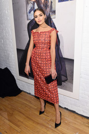 Olivia Culpo kept it ladylike in a coral off-the-shoulder dress at the Zac Posen presentation.